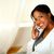 Charming young woman on phone looking at you stock photo © pablocalvog