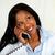 Young black woman conversing on phone stock photo © pablocalvog