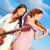two young women playing guitar and violin outdoors stock photo © pekour