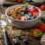 yogurt with baked granola and berries in small bowl stock photo © peteer