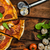 rustico · pizza · salame · mozzarella · spinaci · argilla - foto d'archivio © Peteer