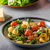 gnocchi with spinach garlic and tomatoes stock photo © peteer