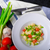 vegetarian gnocchi with spring onions and tomatoes stock photo © peteer