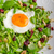 fresh salad with nuts raisins and fried egg stock photo © peteer