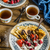 palacsinták · bogyók · házi · készítésű · tejföl · étcsokoládé · cukor - stock fotó © Peteer