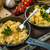 Scrambled eggs with herbs and homemade bread stock photo © Peteer