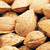 unpeeled almonds nuts background stock photo © petrmalyshev
