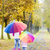 mother and her daughter with umbrellas in autumnal alley stock photo © phbcz