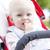 portrait of toddler sitting in a pram stock photo © phbcz