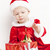 little girl as santa claus with a bell and christmas presents stock photo © phbcz