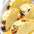 baked tacos filled with minced beef meat beans and tomatoes stock photo © phbcz