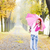 woman wearing rubber boots with umbrella in autumnal alley stock photo © phbcz
