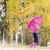 woman wearing rubber boots with umbrella in autumnal nature stock photo © phbcz