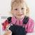 девочку · леденец · фото · Cute · сидят · зеленая · трава - Сток-фото © phbcz