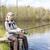 рыбалки · женщину · сидят · пирс · расслабиться · Hat - Сток-фото © phbcz