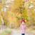 little girl wearing rubber boots in autumnal alley stock photo © phbcz