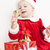 little girl as santa claus with bells and christmas present stock photo © phbcz