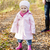 little girl wearing rubber boots in autumnal nature stock photo © phbcz