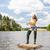 jonge · vrouw · vissen · vijver · zomer · vrouw · bikini - stockfoto © phbcz