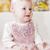 portrait of sitting toddler girl wearing pink dress stock photo © phbcz