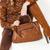 részlet · ül · nő · visel · barna · ruházat - stock fotó © phbcz