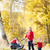 mother and her daughter with a pram on walk in autumnal alley stock photo © phbcz