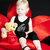 little girl with a teddy bear sitting on red armchair stock photo © phbcz