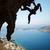 silhueta · feminino · rocha · penhasco · caverna · água - foto stock © photobac