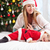 mother playing with baby dressed in santa costume stock photo © photobac