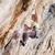 kadın · kaya · uçurum · yüz · genç · duvar - stok fotoğraf © photobac