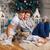 couple reading book to son beside christmas tree stock photo © photobac