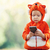 Toddler boy in fox costume holding smartphone stock photo © photobac