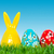 hand painted easter eggs and bunny rabbit toy on grass stock photo © photocreo