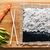 preparing sushi salmon avocado rice and chopsticks on wooden table stock photo © photocreo