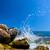 waves hitting rocks on a tropical beach greece santorini stock photo © photocreo