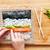 Preparing sushi. Salmon, avocado, rice and chopsticks on wooden table.  stock photo © photocreo