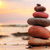 stones pyramid on sand symbolizing zen harmony balance stock photo © photocreo