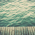 grunge wood boards of a pier over ocean with rippling waves vintage stock photo © photocreo