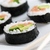 Sushi rolls with salmon, avocado, rice in seaweed and chopsticks on a plate. stock photo © photocreo