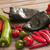various hot peppers scattered on cutting board stock photo © photohome