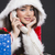Smiling Santa girl on the phone stock photo © photosebia