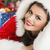 Smiling lady in Santa outfit stock photo © photosebia