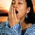 hispanic woman yawning stock photo © piedmontphoto