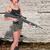 vrouw · aanval · geweer · mooie · jonge · vrouw - stockfoto © piedmontphoto
