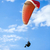 paraglider flying on blue sky stock photo © pixachi