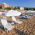 sunbeds and sun umbrellas on the beach stock photo © pixachi