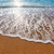 Soft wave of the sea on the sandy beach stock photo © pixachi