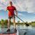 senior athletic paddler on paddleboard stock photo © pixelsaway