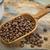 scoop of coffee beans stock photo © pixelsaway
