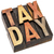 tax day in vintage wood type stock photo © pixelsaway